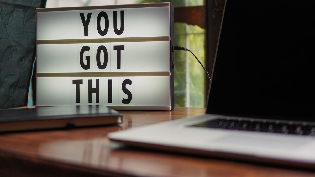 "laptop and sign that says ""you got this"""